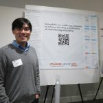 Man standing in front of research poster